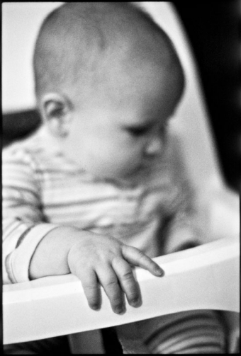 Portrait of a baby in a high chair