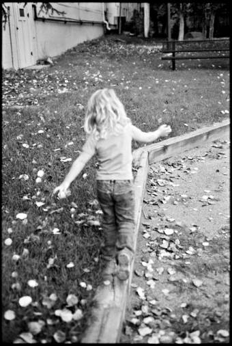 A little girl walks away from the camera