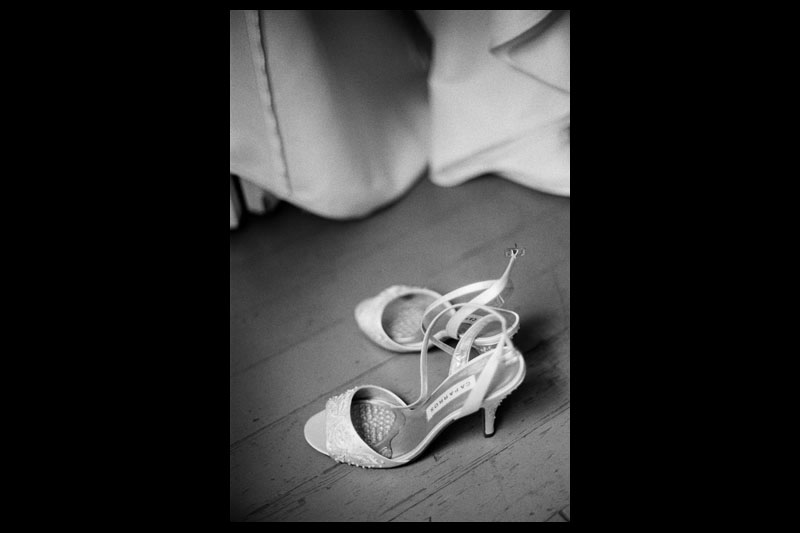 The bride's shoes set on the floor