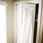 Wedding dress hangs over the closet door