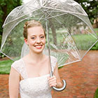 The Bride stands for a portrait in the rain