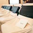 Detail image of the chairs set up for a wedding ceremony