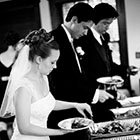 The Bride and Groom serve themselves dinner