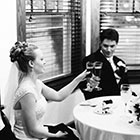 The Bride and Groom toast with champagne glasses