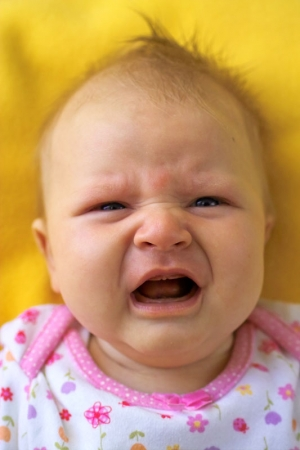 Portrait of a crying baby girl