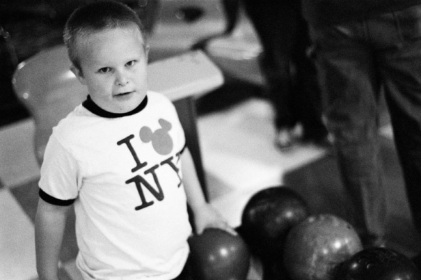 A five year old boy picks up his bowling ball