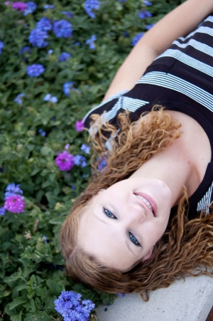 Senior portrait of a young woman lying down.