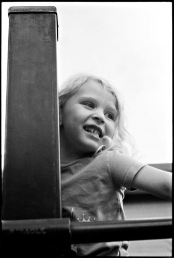 A little girl plays on playground equipment
