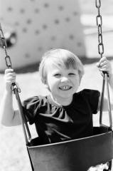 Little girl swinging at the park