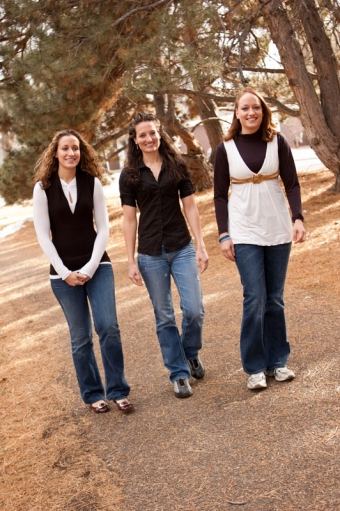 Three sisters smiling and walking