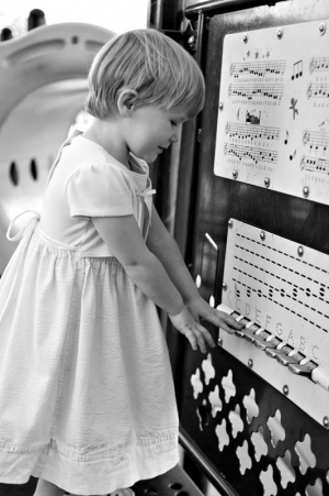 Three year old girl playing a