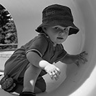 A toddler crawls through a tunnel