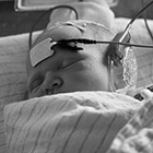 A newborn baby has her hearing tested