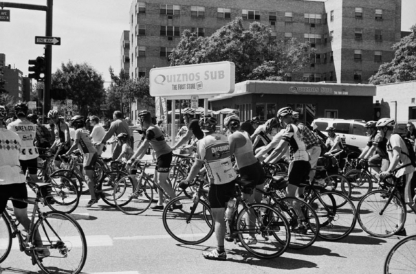 A group of cyclists outside of the first Quiznos store