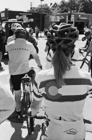 Cyclists in Livestrong and Colorado jerseys