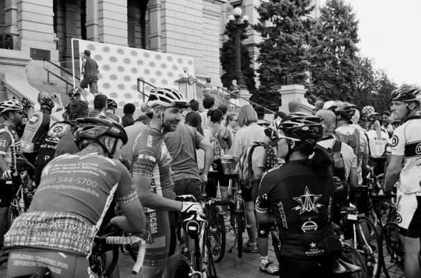 Cyclists talk as they wait for a  press conference