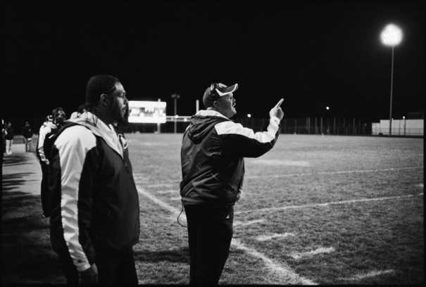 A coach shouts on to the field