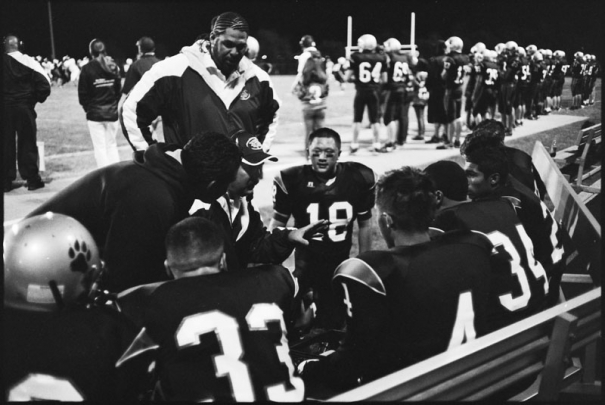 A coach talks to his players