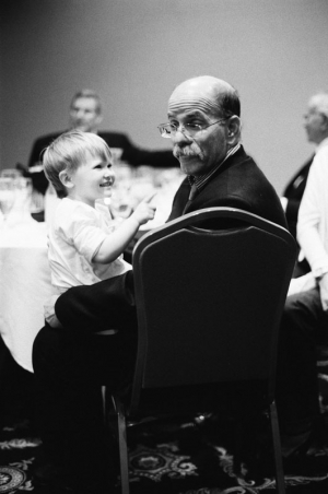 A two year old girl plays with her grandfather at a hotel reception the night before a Bat Mitzvah in Salt Lake City, Utah.
