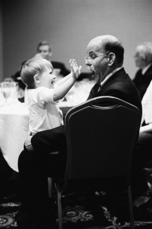 A two year old girl surprises her grandfather at a hotel reception the night before a Bat Mitzvah in Salt Lake City, Utah.