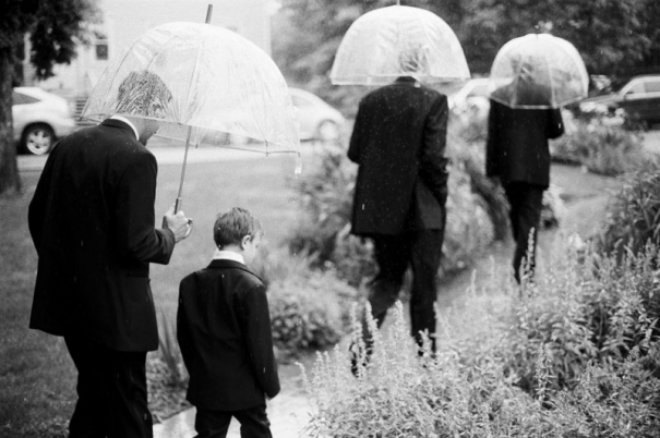 Groomsmen and ring bearer walking in the rain