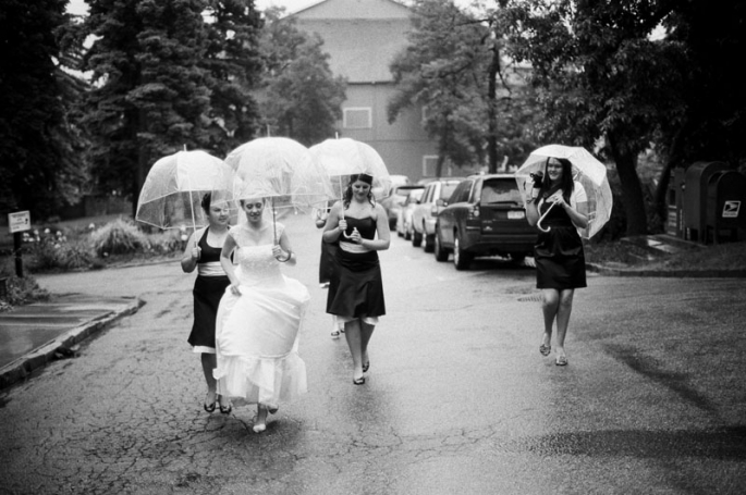 A bride and her bridesmaids walking up the street
