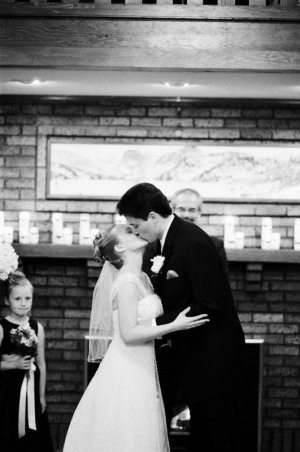 The bride and groom share their first kiss