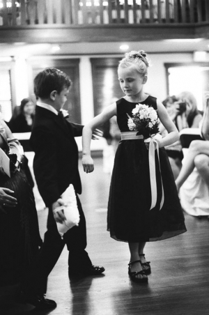 The ring bearer and flower girl meet in the center aisle
