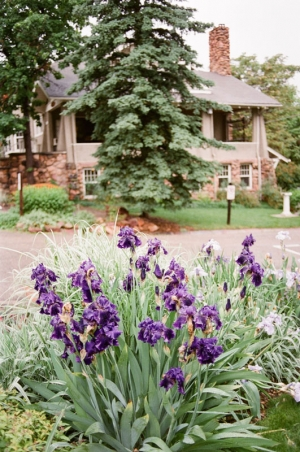 Flowers and the exterior of the Chautauqua Community House