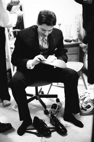 The Groom works on his shoes