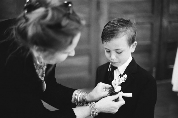 The ring bearer has his boutonniere pinned on