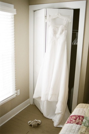 Wedding dress hangs over the closet door
