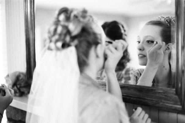 Bride applying make-up