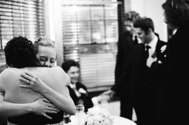 The Bride hugs one of her bridesmaids