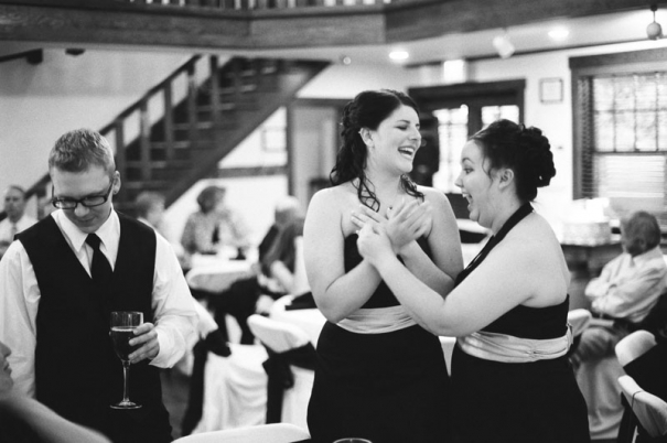 Two bridesmaids share a laugh