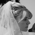 Profile view of a bride in her veil