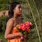 Maid of Honor holds the Bride's bouquet