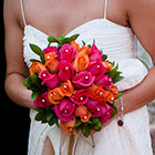 Bride holding her colorful bouquet