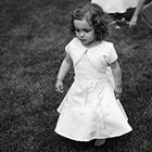 Flower Girl Walks on the Grass