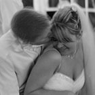 Groom Steals a Kiss